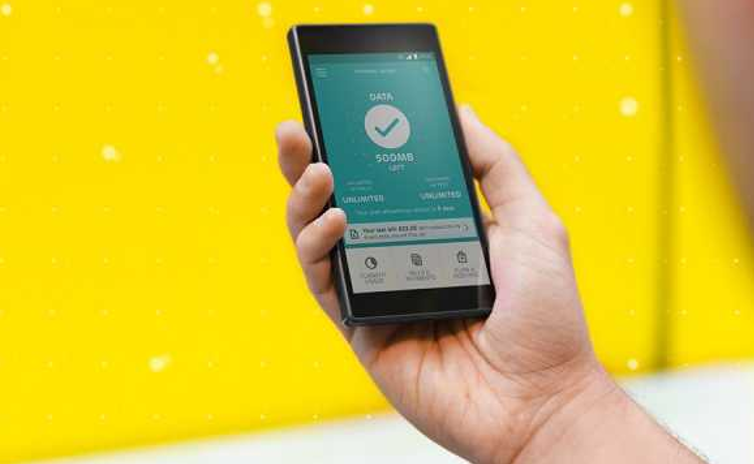 EE £2.7m fine - Man holds EE phone stock