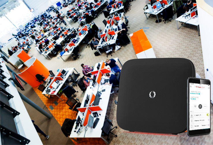 Vodafone call centre stock overhead with router composite
